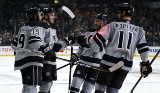 Los Angeles Kings forward Matt Roy. second from left, celebrates his goal with teammates during the second period of an NHL hockey game against Vegas Golden Knights on Saturday, April 6, 2019, in Los Angeles. (AP Photo/Ringo H.W. Chiu)
