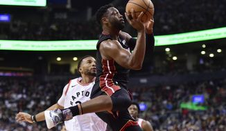 Miami Heat guard Dwyane Wade (3) drives past Toronto Raptors forward Norman Powell (24) on his way to the net during second-half NBA basketball action in Toronto, Sunday, April 7, 2019. (Frank Gunn/The Canadian Press via AP)