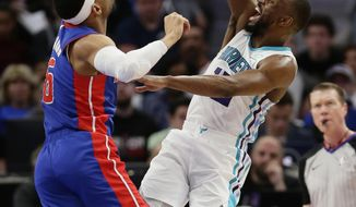 Charlotte Hornets guard Kemba Walker (15) shoots against Detroit Pistons guard Bruce Brown (6) during the first half of an NBA basketball game Sunday, April 7, 2019, in Detroit. (AP Photo/Duane Burleson)