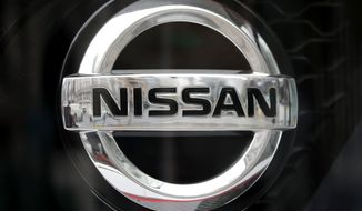 Nissan logo is seen at the automaker's showroom in Tokyo, Monday, April 8, 2019. Nissan Chief Executive Hiroto Saikawa has apologized to shareholders for the unfolding scandal at the Japanese automaker and asked for their approval to oust from the board former Chairman Carlos Ghosn, who has been arrested on financial misconduct charges.(AP Photo/Shuji Kajiyama)