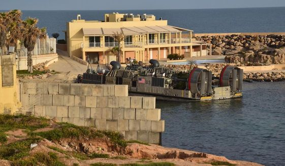 A U.S. amphibious hovercraft departs with evacuees from Janzur, west of Tripoli, Libya, Sunday, April 7, 2019. The United States says it has temporarily withdrawn some of its forces from Libya due to deteriorating security conditions. The pullout comes as a Libyan commander's forces advanced toward the capital of Tripoli and clashed with rival militias. A small contingent of American troops has been in Libya in recent years helping local forces combat Islamic State and al-Qaida militants and protecting diplomatic facilities. (AP Photo/Mohammed Omar Aburas)