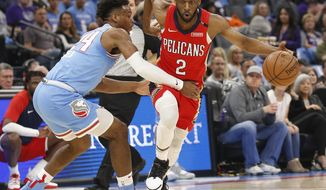 Sacramento Kings guard Buddy Hield, left, tries to stop New Orleans Pelicans guard Ian Clark during the first half of an NBA basketball game Sunday, April 7, 2019, in Sacramento, Calif. (AP Photo/Rich Pedroncelli)