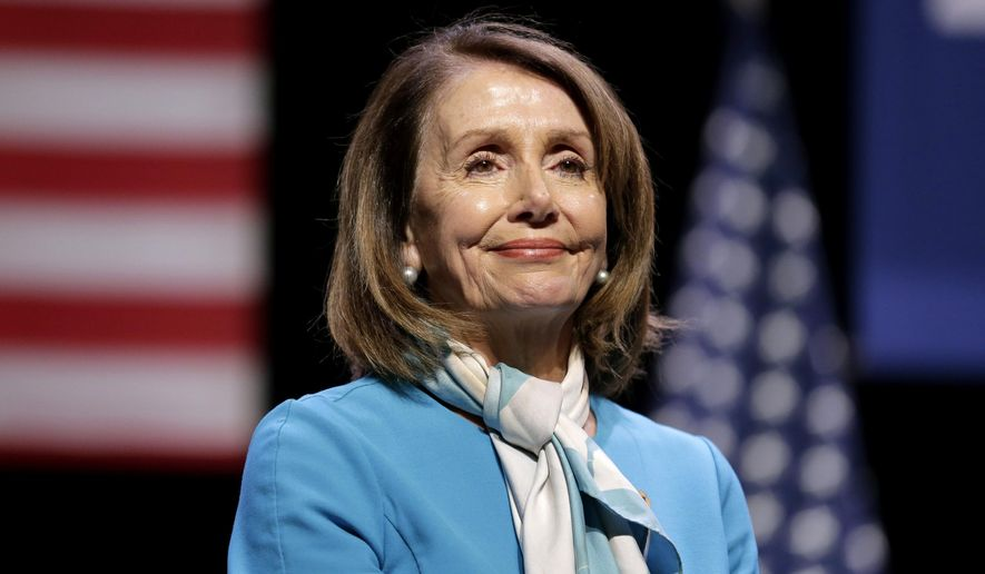 """In this Feb. 25, 2019, file photo, House Speaker Nancy Pelosi smiles while attending a bill signing ceremony in New York.  Pelosi has been named the recipient of the 2019 John F. Kennedy Profile in Courage Award. Caroline Kennedy, the daughter of the late president, said in a statement Sunday, April 7 that the California Democrat is """"the most important woman in American political history."""" (AP Photo/Seth Wenig, File)"""