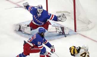 New York Rangers goaltender Henrik Lundqvist (30) stretches to make a save on a shot by Boston Bruins right wing David Backes (42) during the third period of an NHL hockey game in Boston, Wednesday, March 27, 2019. At lower left is New York Rangers center Mika Zibanejad. (AP Photo/Charles Krupa)