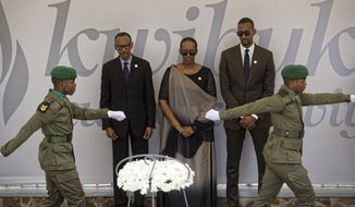 Rwanda's President Paul Kagame, center-left, First Lady Jeannette Kagame, center, and son Ivan Cyomoro Kagame, right, prepare to lay a wreath at the Kigali Genocide Memorial in Kigali, Rwanda Sunday, April 7, 2019. Rwanda is commemorating the 25th anniversary of when the country descended into an orgy of violence in which some 800,000 Tutsis and moderate Hutus were massacred by the majority Hutu population over a 100-day period in what was the worst genocide in recent history. (AP Photo/Ben Curtis)