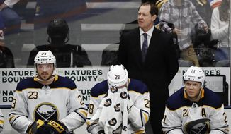 Buffalo Sabres head coach Phil Housley, top, Sam Reinhart (23), Zemgus Girgensons (28) and Kyle Okposo (21) react during the third period of an NHL hockey game against the New York Islanders, Saturday, March 30, 2019, in Uniondale, N.Y. (AP Photo/Frank Franklin II)