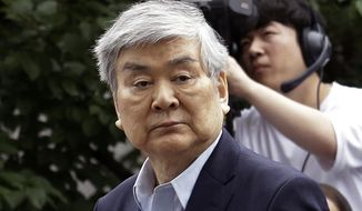 In this July 5, 2018, file photo, Cho Yang-ho, the chairman of Korean Air Lines Co., arrives for hearing to review the prosecution's request for an arrest warrant on charges of embezzlement at the Seoul Southern District Court in Seoul, South Korea. (AP Photo/Ahn Young-joon, File)