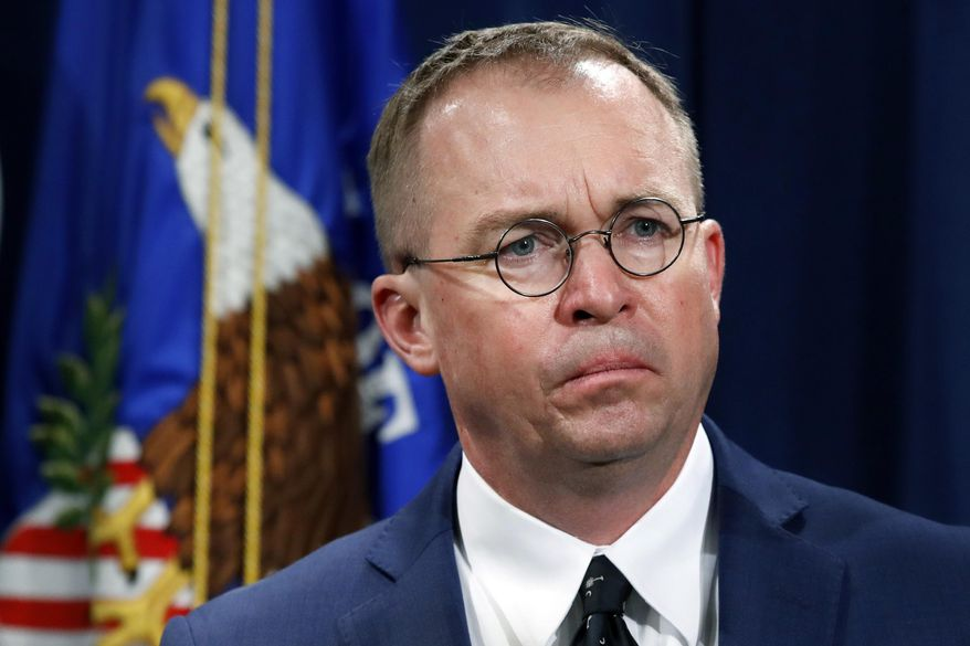"""In this July 11, 2018, file photo, Mick Mulvaney, acting director of the Consumer Financial Protection Bureau (CFPB), and director of the Office of Management, listens during a news conference at the Department of Justice in Washington. White House Chief of Staff Mulvaney said in an interview with """"Fox News Sunday"""" Democrats will """"never"""" see President Donald Trump's tax returns. (AP Photo/Jacquelyn Martin, File) **FILE**"""