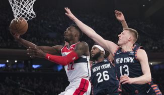 Washington Wizards forward Jeff Green (32) goes to the basket past New York Knicks center Mitchell Robinson (26) and forward Henry Ellenson (13) during the first half of an NBA basketball game, Sunday, April 7, 2019, at Madison Square Garden in New York. (AP Photo/Mary Altaffer)
