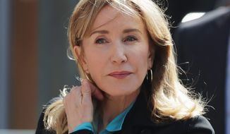 """My daughter knew absolutely nothing about my actions, and in my misguided and profoundly wrong way, I have betrayed her,"" said Felicity Huffman. (ASSOCIATED PRESS)"
