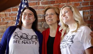 2020 Democratic presidential candidate Sen. Elizabeth Warren, center, poses for a photo with local residents during an organizing event, Friday, March 1, 2019, in Dubuque, Iowa. (AP Photo/Charlie Neibergall)