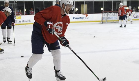 Washington Capitals Evgeny Kuznetsov skates during a team practice in Arlington, Va., Monday, April 8, 2019. (AP Photo/Susan Walsh) ** FILE **