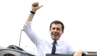 South Bend, Ind. Mayor Pete Buttigieg flashes a thumbs-up as he prepares to depart after speaking at a meet and greet event at MadHouse Coffee on Monday, April 8, 2019, in Las Vegas. (Bizuayehu Tesfaye/Las Vegas Review-Journal via AP)