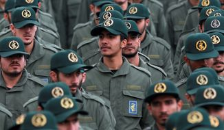 In this Feb. 11, 2019 file photo, Iranian Revolutionary Guard members attend a ceremony celebrating the 40th anniversary of the Islamic Revolution, at the Azadi, or Freedom, Square in Tehran, Iran. On Monday, April 8, 2019, the Trump administration designated Irans Revolutionary Guard a foreign terrorist organization in an unprecedented move against a national armed force. Irans Revolutionary Guard Corps went from being a domestic security force with origins in the 1979 Islamic Revolution to a transnational fighting force. (AP Photo/Vahid Salemi)