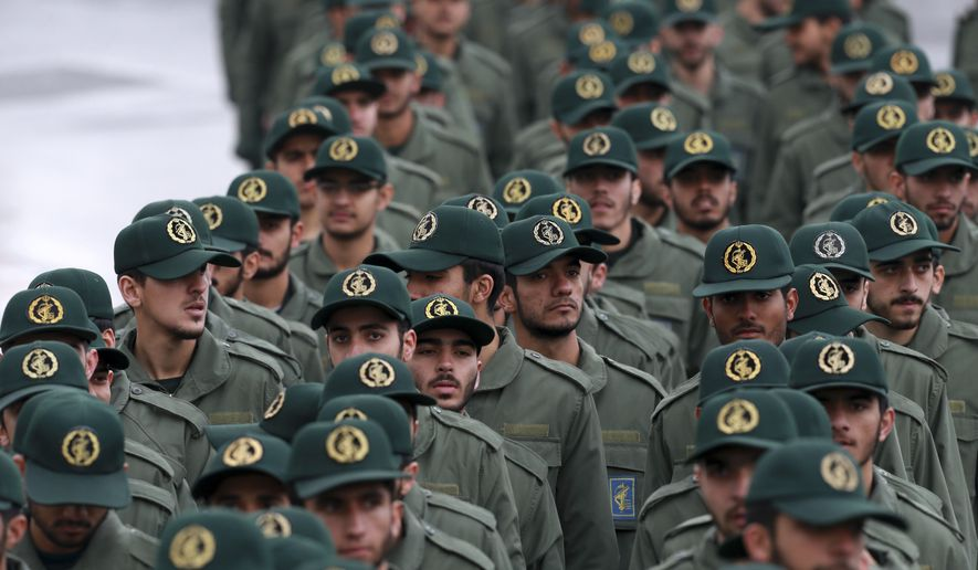 In this Feb. 11, 2019, file photo, Iranian Revolutionary Guard members arrive for a ceremony celebrating the 40th anniversary of the Islamic Revolution, at the Azadi, or Freedom, Square, in Tehran, Iran. (AP Photo/Vahid Salemi) ** FILE **