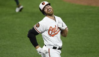 Baltimore Orioles' Chris Davis reacts after he lined out during the third inning of a baseball game against the Oakland Athletics, Monday, April 8, 2019, in Baltimore. (AP Photo/Nick Wass)
