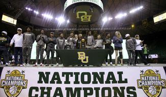 Baylor players are welcomed home inside the Ferrell Center, Monday, April 8, 2019, in Waco, Texas, as the NCAA Division I Women's basketball champions. (Jerry Larson/ Waco Tribune Herald via AP)