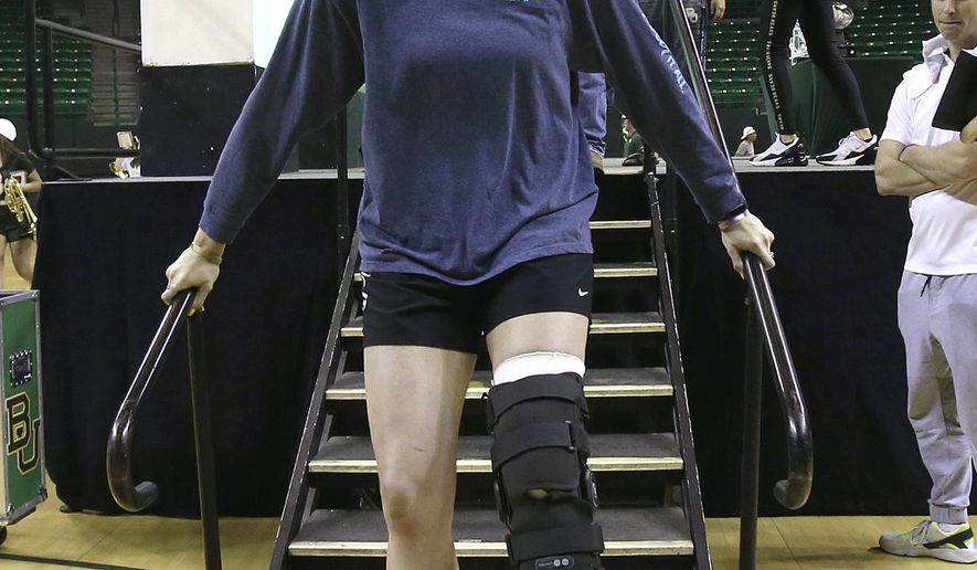 Baylor's Lauren Cox exits the stage after a welcome home celebration for the NCAA Division I women's basketball champions inside the Ferrell Center, Monday April 8, 2019, in Waco, Texas. (Jerry Larson/Waco Tribune Herald via AP)