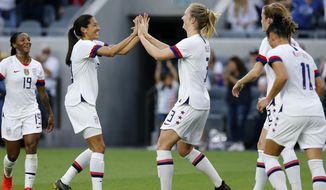 U.S. midfielder Samantha Mewis, center, celebrates her goal with forward Carli Lloyd, second from left, against Belgium during the first half of an international friendly soccer match Sunday, April 7, 2019, in Los Angeles. (AP Photo/Ringo H.W. Chiu)