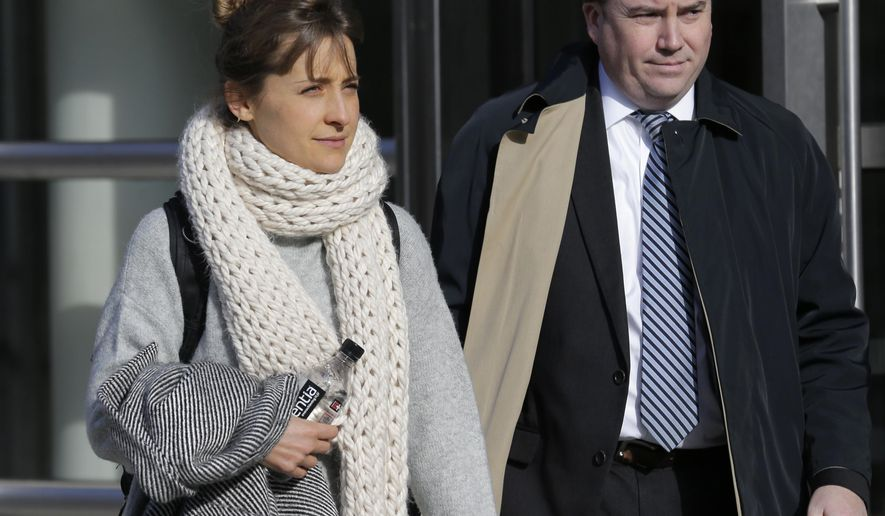 FILE - In this Dec. 6, 2018, file photo, television actress Allison Mack leaves federal court in New York. Jury selection is set to begin for a trial featuring sensational allegations that a cult-like group based in upstate New York turned women into sex slaves who were branded with the initials of its spiritual leader. Prosecutors say the purported self-help group called NXIVM formed a secret society of women who had unwanted sex with guru Keith Raniere. Raniere and three co-defendants including heiress Clare Bronfman and TV actress Allison Mack have pleaded not guilty to conspiracy and other charges in the sex-trafficking case. Potential jurors will be asked to fill out questionnaires Monday, April 8, 2019, in federal court in Brooklyn. (AP Photo/Seth Wenig, File)