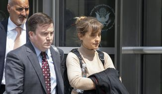 Actress Allison Mack leaves Brooklyn federal court Monday, April 8, 2019, in New York. Mack pleaded guilty to racketeering charges on Monday in a case involving a cult-like group based in upstate New York. The trial is expected to detail sensational allegations that the group, called NXIVM, recruited sex slaves for its spiritual leader, Keith Raniere. (AP Photo/Mark Lennihan)