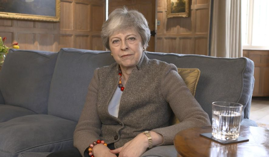 In this image taken from video released by Downing Street, Sunday April 7, 2019, showing Britain's Prime Minister Theresa May defending her position on Brexit, and her decision to hold cross-party talks with opposition Labour Party, in a video message filmed at her Chequers country retreat.  Cross-party talks over Brexit are expected to resume before the U.K.'s Friday deadline for leaving the European Union. (Downing Street via AP)