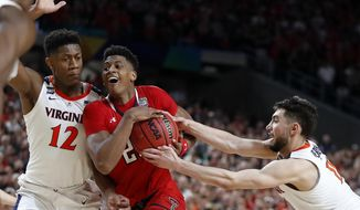 Texas Tech's Jarrett Culver (23) drives against Virginia's Ty Jerome (11) and De'Andre Hunter (12) during the overtime in the championship of the Final Four NCAA college basketball tournament, Monday, April 8, 2019, in Minneapolis. (AP Photo/Jeff Roberson) ** FILE **