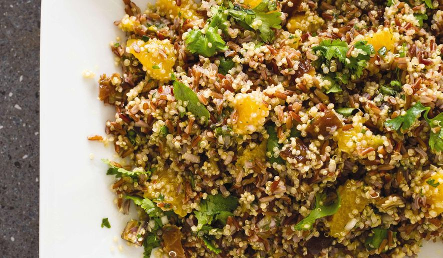 """This undated photo provided by America's Test Kitchen in March 2019 shows Red Rice and Quinoa Salad in Brookline, Mass. This recipe appears in the cookbook """"Vegan for Everybody."""" (Carl Tremblay/America's Test Kitchen via AP)"""