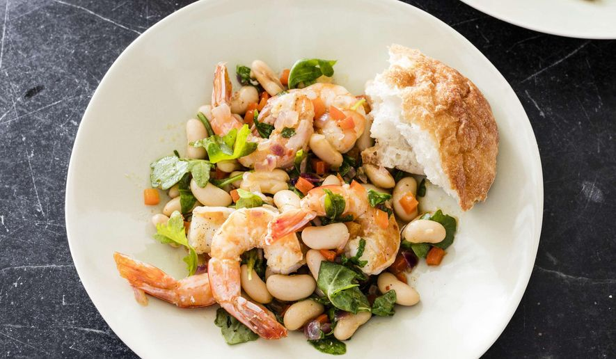 "This undated photo provided by America's Test Kitchen in March 2019 shows Shrimp with White Beans in Brookline, Mass. This recipe appears in ""The Complete Mediterranean Cookbook."" (Daniel J. van Ackere/America's Test Kitchen via AP)"
