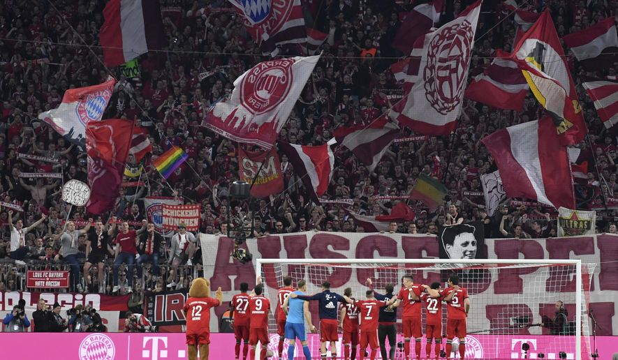 Bayern players celebrate their win after the German Bundesliga soccer match between FC Bayern Munich and Borussia Dortmund in the Allianz Arena in Munich, Germany, on Saturday, April 6, 2019. Bayern won 5-0. (AP Photo/Kerstin Joensson)
