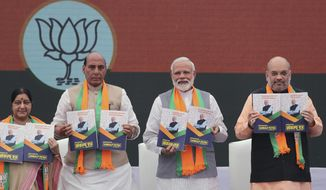 From Left, Indian Foreign Minister Suushma Swaraj, Home Minister Rajnath Singh, Indian Prime Minister Narendra Modi, Bharatiya Janata Party (BJP) president Amit Shah release BJP's manifesto for the upcoming general elections in New Delhi, India, Monday, April 8, 2019. India's general elections are scheduled to be held in seven phases starting from April 11. Votes will be counted on May 23. (AP Photo/Manish Swarup)