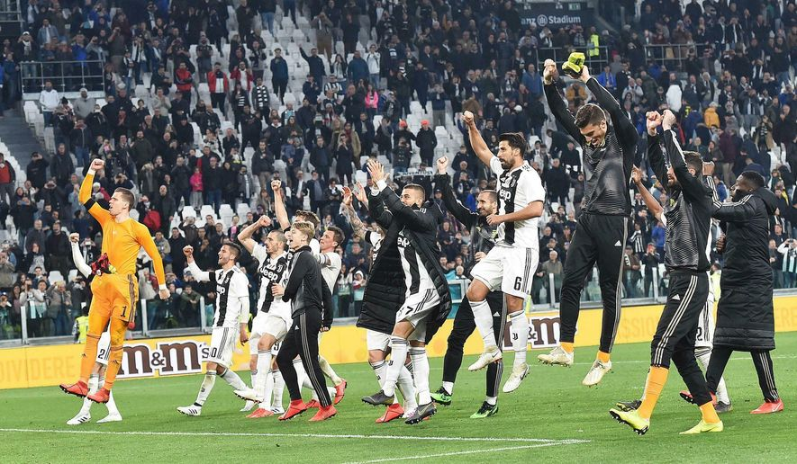 Juventus celebrate their victory at the end of the Italian Serie A soccer match between Juventus and AC Milan at the Allianz Stadium in Turin, Italy, Saturday, April 6, 2019.  (Andrea Di Marco/ANSA via AP)