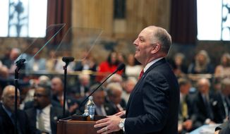 In this file photo, Louisiana Democratic Gov. John Bel Edwards speaks at the opening of the annual state legislative session in Baton Rouge, La., Monday, April 8, 2019. On Sept. 25, 2019, the state legislature's chief economist said that the state's budget surplus is attributable to federal tax reforms signed into law by President Trump. (AP Photo/Gerald Herbert, pool) **FILE**