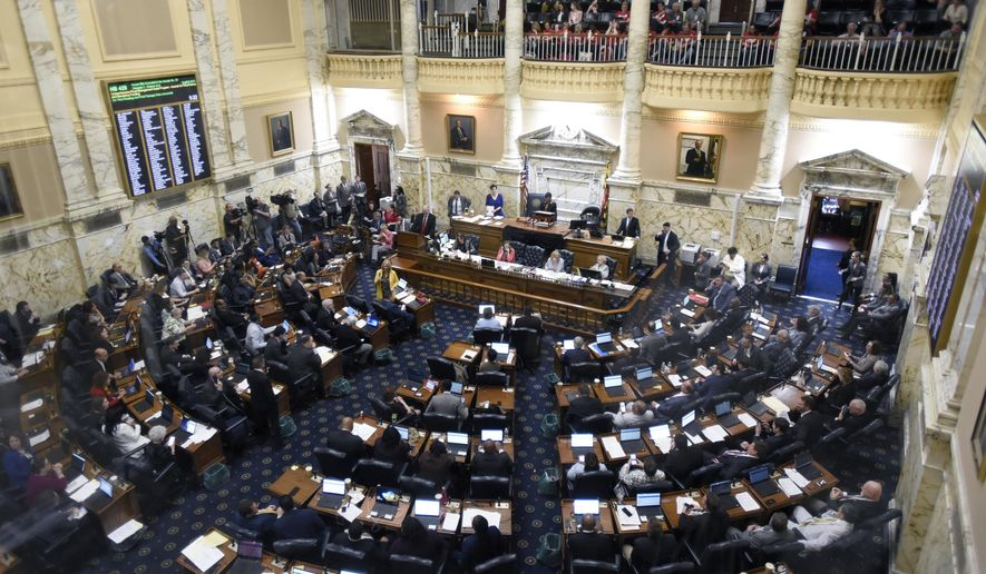 State delegates work in the Maryland House of Delegates chamber in Annapolis, Md., Monday, April 8, 2019, the final day of the state's 2019 legislative session. (AP Photo/Steve Ruark)