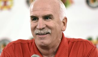 FILE - In this July 21, 2017 file photo, Chicago Blackhawks' head coach Joel Quenneville speaks at a news conference during the NHL hockey team's convention in Chicago. Quenneville — who is second on the NHL's all-time victory list — was hired Monday, April 8, 2019, to coach the Florida Panthers. (AP Photo/G-Jun Yam, File) **FILE**