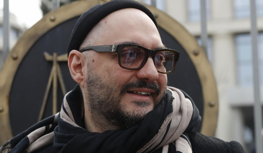 Russian theatre and film director Kirill Serebrennikov speaks to the media after a court hearing in Moscow, Russia, Monday, April 8, 2019. Moscow City Court released Serebrennikov from the house arrest on his own recognizance. (AP Photo/Pavel Golovkin)