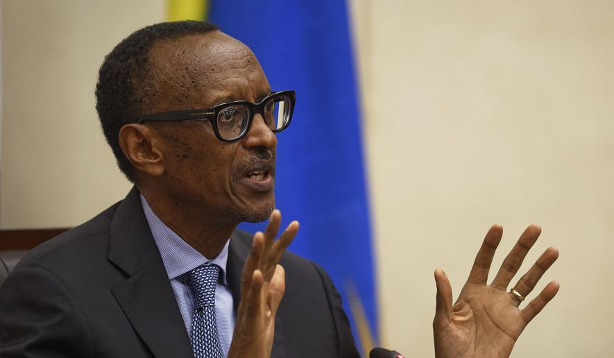 Rwanda's President Paul Kagame answers questions from the media at a press conference at a convention center in the capital Kigali, Rwanda, Monday, April 8, 2019. Rwanda on Sunday commemorated the 25th anniversary of when the country descended into an orgy of violence in which some 800,000 Tutsis and moderate Hutus were massacred by the majority Hutu population over a 100-day period in what was the worst genocide in recent history. (AP Photo/Ben Curtis)