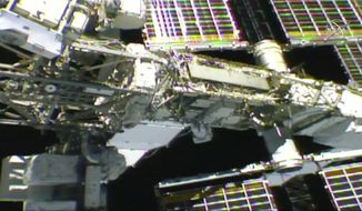 In this photo provided by NASA, NASA astronaut Anne McClain works outside the International Space Station, Monday, April 8, 2019. McClain and Canadian astronaut David Saint-Jacques got an early start Monday morning as they tackled battery and cable work outside the International Space Station. It's the third spacewalk in just 2 ½ weeks for the station crew.  (NASA via AP)