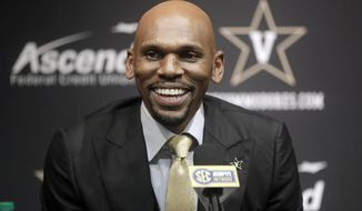 Vanderbilt basketball coach Jerry Stackhouse answers questions at a news conference Monday, April 8, 2019, in Nashville, Tenn. Stackhouse was hired to replace Bryce Drew as head. (AP Photo/Mark Humphrey)