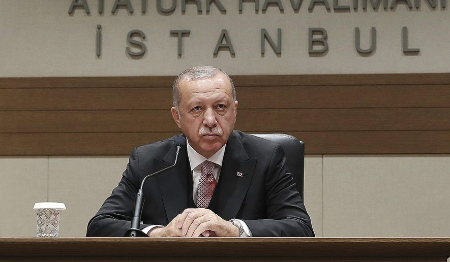 Turkey's President Recep Tayyip Erdogan talks to members of the media regarding the local elections, in Istanbul, Monday, April 8, 2019, prior to his departure for Russia. (Presidential Press Service via AP, Pool)