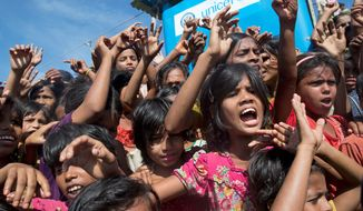 Rohingya refugee children shout slogans during a protest against the repatriation process at Unchiprang refugee camp near Cox's Bazar, in Bangladesh, Thursday, Nov. 15, 2018. The head of Bangladesh's refugee commission said plans to begin a voluntary repatriation of Rohingya Muslim refugees to their native Myanmar on Thursday were scrapped after officials were unable to find anyone who wanted to return. (AP Photo/Dar Yasin)