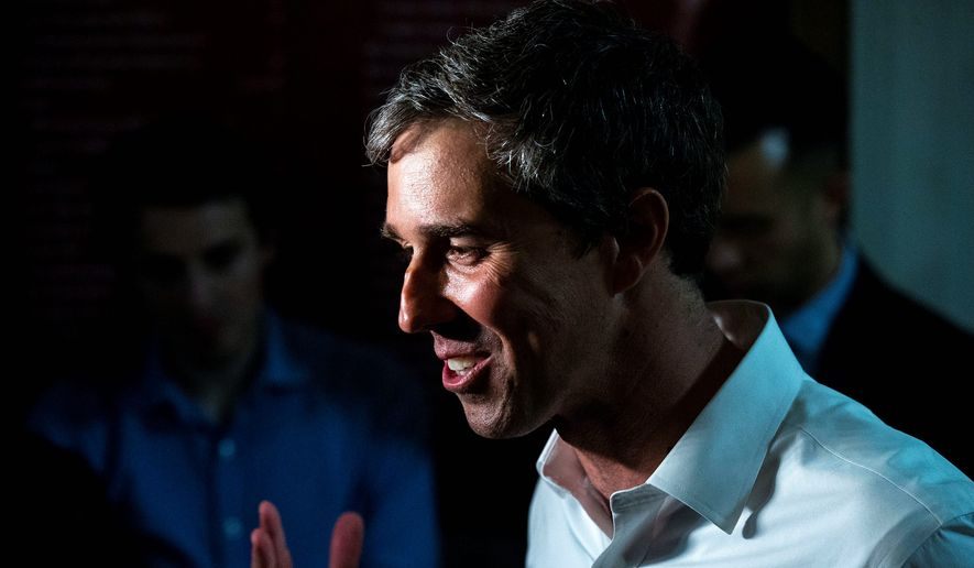 Democratic presidential candidate Beto O'Rourke answers questions from the press after speaking on the Iowa State University campus, on Wednesday, April 3, 2019, in Ames, Iowa. This is O'Rourke's second trip to Iowa after announcing his campaign. (Kelsey Kremer/The Des Moines Register via AP)