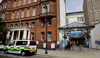 An exterior view shows the main entrance to Great Ormond Street Hospital in London. (AP Photo/Matt Dunham) ** FILE **