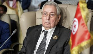 In this March 31, 2019, file photo, Algeria's Abdelkader Bensalah attends the opening session of the 30th Arab Summit in Tunis, Tunisia. The parliament on Tuesday named Abdelkader Bensalah, the leader of parliament's upper chamber, as president for a maximum 90 days as is called for by the constitution until a new election can be organized. Bensalah was a key ally of Bouteflika. (Fethi Belaid/ Pool photo via AP, File)