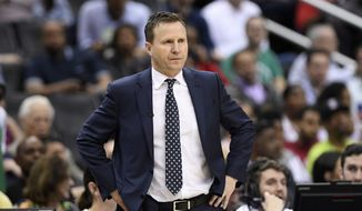 Washington Wizards coach Scott Brooks watches during the second half of the team's NBA basketball game against the Boston Celtics, Tuesday, April 9, 2019, in Washington. The Celtics won 116-110. (AP Photo/Nick Wass)