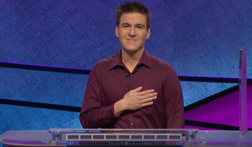 """This image made from video aired on """"Jeopardy!"""" on Tuesday, April 9. 2019, and provided by Jeopardy Productions, Inc. shows James Holzhauer.  The 34-year-old professional sports gambler from Las Vegas won more than $110,000 on """"Jeopardy!"""" on Tuesday, breaking the record for single-day cash winnings. (Jeopardy Productions, Inc. via AP)"""