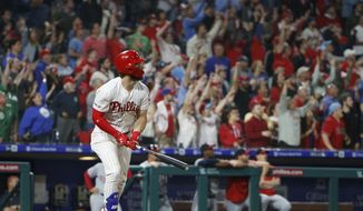 Philadelphia Phillies' Bryce Harper hits a three run home run during the third inning of a baseball game against the Washington Nationals, Tuesday, April 9, 2019, in Philadelphia. (AP Photo/Chris Szagola)