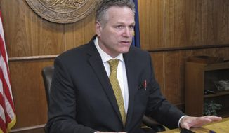 Alaska Gov. Mike Dunleavy speaks to reporters during a news conference on Tuesday, April 9, 2019, in Juneau, Alaska, that focused on the state budget. Dunleavy questioned the potential for any deal with lawmakers if they failed to act on his proposed constitutional amendments and crime bills. (AP Photo/Becky Bohrer)