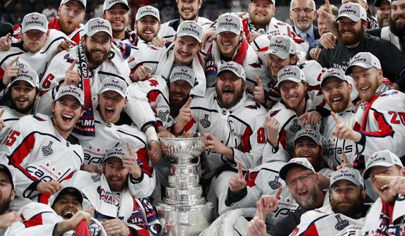 Members of the Washington Capitals pose with the Stanley Cup after the Capitals defeated the Golden Knights 4-3 in Game 5 of the NHL hockey Stanley Cup Finals Thursday, June 7, 2018, in Las Vegas. For once, Alex Ovechkin and the rest of the Washington Capitals head into the NHL playoffs without having to hear _ and answer _ so many of those same, old same-olds.(AP Photo/John Locher, File)