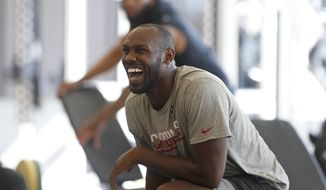 Arizona Cardinals linebacker Chandler Jones laughs with a teammate as he takes part in the team's offseason strength and conditioning program at the Cardinals NFL training center, Tuesday, April 9, 2019 in Tempe, Ariz. (AP Photo/Ralph Freso)